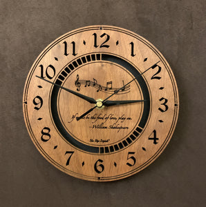 "Round walnut clock with music notes and the words, ""If music be the food of love, play on"" lasered on face - larger sizes"