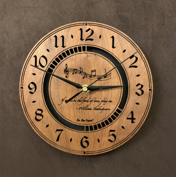 Round walnut clock with music notes and the words,