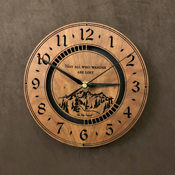 Round walnut clock with a mountain and the words,