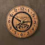 "Round walnut clock with a mountain and the words, ""Not all who wander are lost"" lasered in the face - larger sizes"