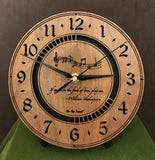 "Round walnut clock with music notes and the words, ""If music be the food of love, play on"" lasered on face - 8"" on easel"