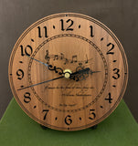 "Round walnut clock with music notes and the words, ""If music be the food of love, play on"" lasered on face - 6.5"" on easel"