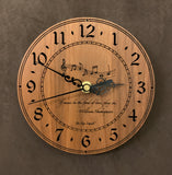 "Round walnut clock with music notes and the words, ""If music be the food of love, play on"" lasered on face - 6.5"" size"