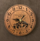 "Round walnut clock with a mountain and the words, ""Not all who wander are lost"" lasered in the face - 6.5"" size"