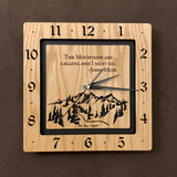 "A square oak clock with the numbers on the outer square section, while on the inner square section a mountain and the words, ""The Mountains are calling and I must go. -John Muir"" are lasered in the wood. The concentric wood squares have a gap between them and are against a black background. Larger Sizes"