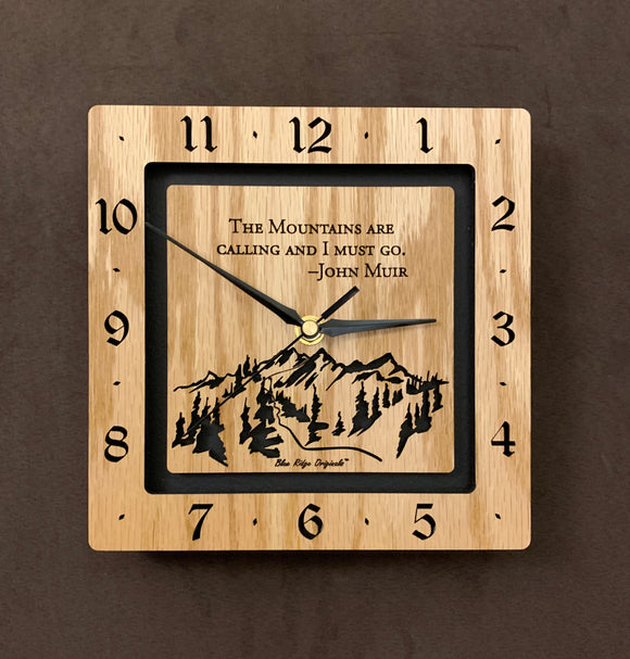 A square oak clock with the numbers on the outer square section, while on the inner square section a mountain and the words,