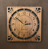 "A square walnut clock with cutouts forming a patterned circle around the face and numbers of the clock and cutout flourishes in the corners. Somewhat in an Art Deco style. 10"" Size"