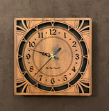 "A square walnut clock with cutouts forming a patterned circle around the face and numbers of the clock and cutout flourishes in the corners. Somewhat in an Art Deco style. 8"" Size"