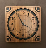 A square walnut clock with cutouts forming a patterned circle around the face and numbers of the clock and cutout flourishes in the corners. Somewhat in an Art Deco style. Larger Sizes