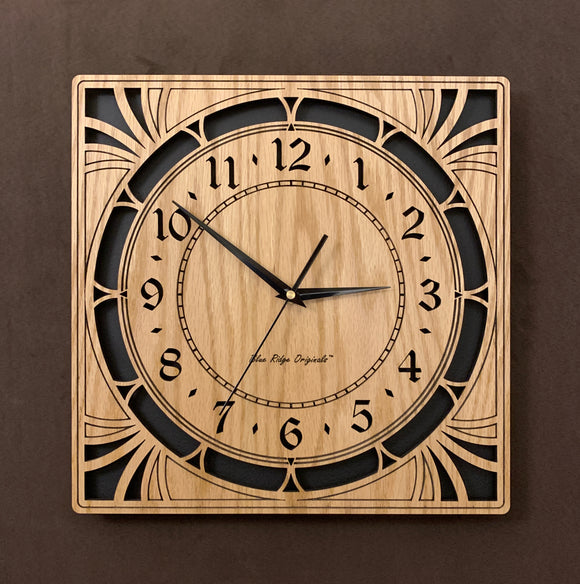 A square oak clock with cutouts forming a patterned circle around the face and numbers of the clock and cutout flourishes in the corners. Somewhat in an Art Deco style. Larger Sizes
