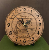 "Round walnut clock with an ocean scene of sun, birds and ripples in the water along with the words, ""The ocean is calling and I must go"" lasered in the face - 6.5"" on easel"