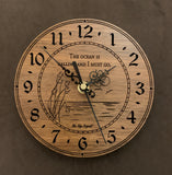 "Round walnut clock with an ocean scene of sun, birds and ripples in the water along with the words, ""The ocean is calling and I must go"" lasered in the face - 6.5"" size"