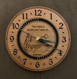 "Round walnut clock with an ocean scene of sun, birds and ripples in the water along with the words, ""The ocean is calling and I must go"" lasered in the face - larger sizes"