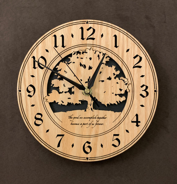 Round oak clock with a tree and the words,