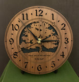 "Walnut clock with lasered tree and small bird, with the words, ""Family gives us roots and wings"" - on easel"