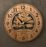 "Walnut clock with lasered tree and small bird, with the words, ""Family gives us roots and wings"" - Larder sizes"