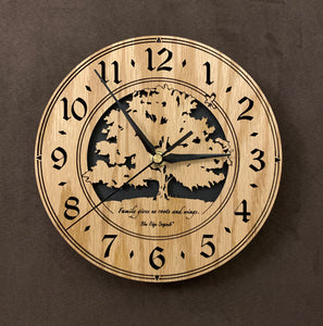 "Oak clock with lasered tree and small bird, with the words, ""Family gives us roots and wings"" - Larger sizes"