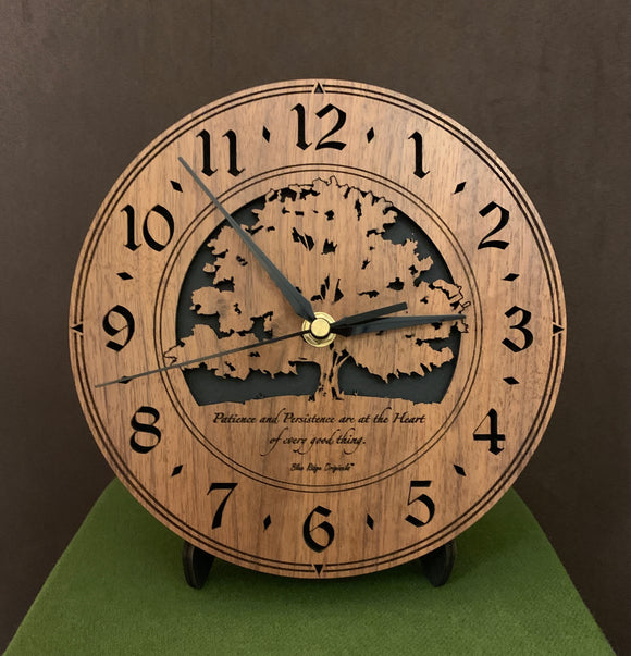 Round walnut clock with a tree and the words,