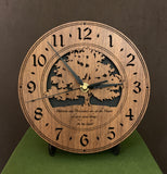 "Round walnut clock with a tree and the words, ""Patience and persistence are at the heart of every good thing"" lasered on face - 8"" on easel"
