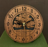 "Round walnut clock with a tree and the words, ""Patience and persistence are at the heart of every good thing"" lasered on face - 6.5"" on easel"