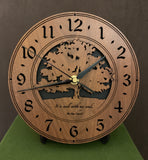 "Round walnut clock with a tree and the words, ""It is well with my soul"" lasered on face - 8"" on easel"