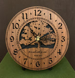 "Round walnut clock with a tree and the words, ""It is well with my soul"" lasered on face - 6.5"" size on easel"