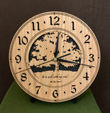 "Round oak clock with a tree and the words, ""It is well with my soul"" lasered on face - 8"" on easel"