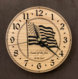 "Round oak clock with a lasered American flag and black background with the words ""Land of the free""  - 6.5"" size"