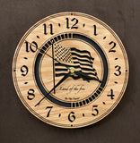 "Round oak clock with a lasered American flag and black background with the words ""Land of the free""  - larger sizes"