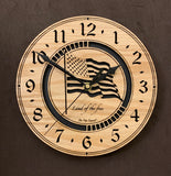 "Round oak clock with a lasered American flag and black background with the words ""Land of the free""  - 9.1"" Size"