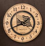 "Round oak clock with a lasered American flag and black background with the words ""Land of the free""  - largest sizes"