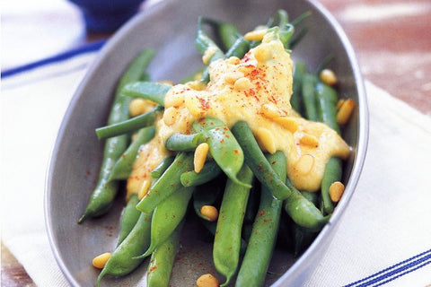 Beans with hummus dressing and pine nuts