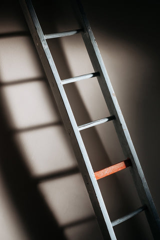 Ladder with one orange rung
