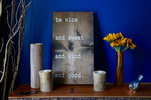 "Carved ""Be nice"" sign"