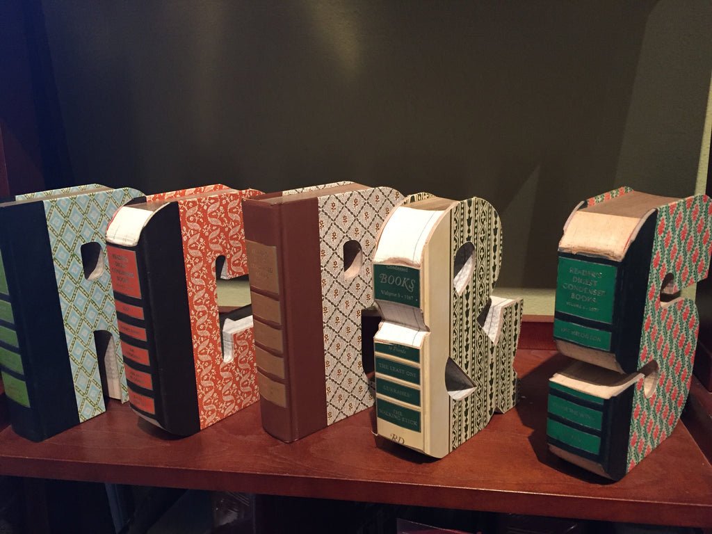 Capital letters cut from Books
