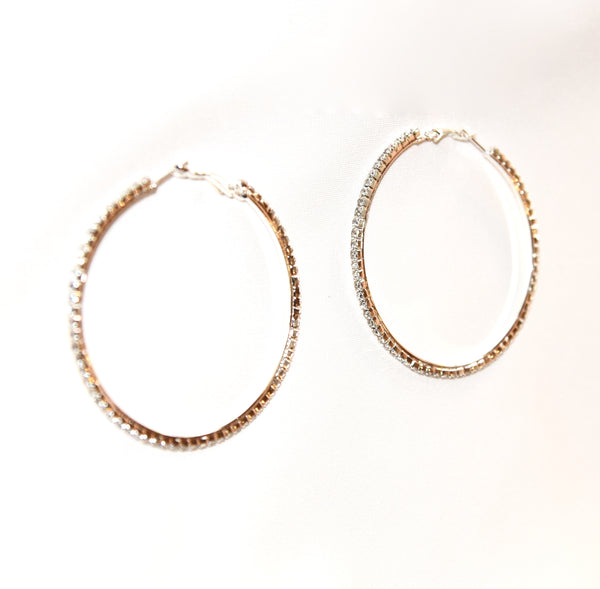 Golden metal hoop earrings, rhinestones