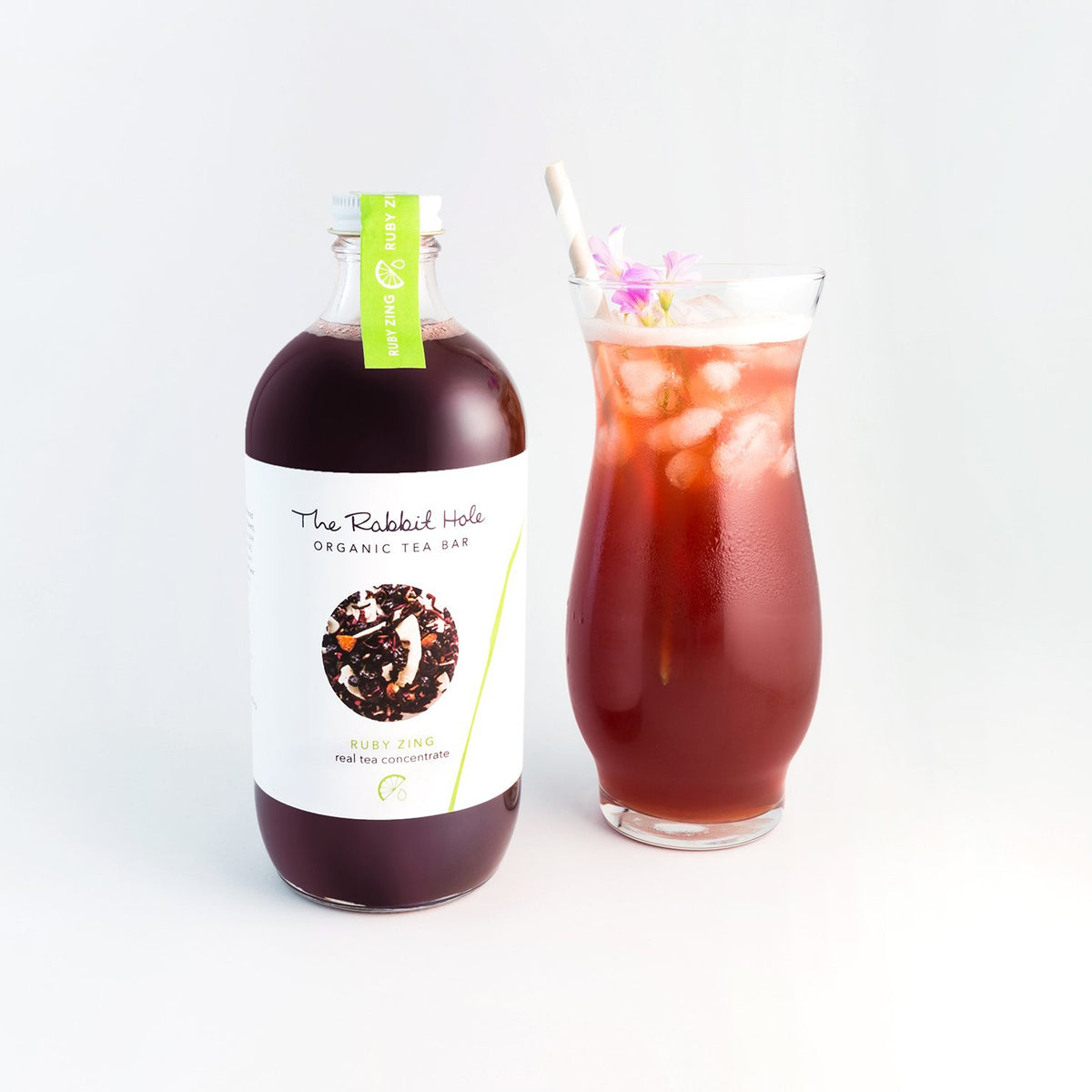 Ruby Zing real tea concentrate by The Rabbit Hole - iced tea mixer with tall glass of iced tea