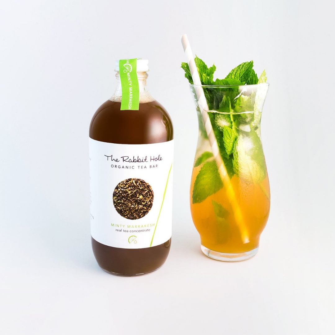 The Rabbit Hole Minty Marrakesh Tea Mixer - Tea concentrate with iced tea in tall glass