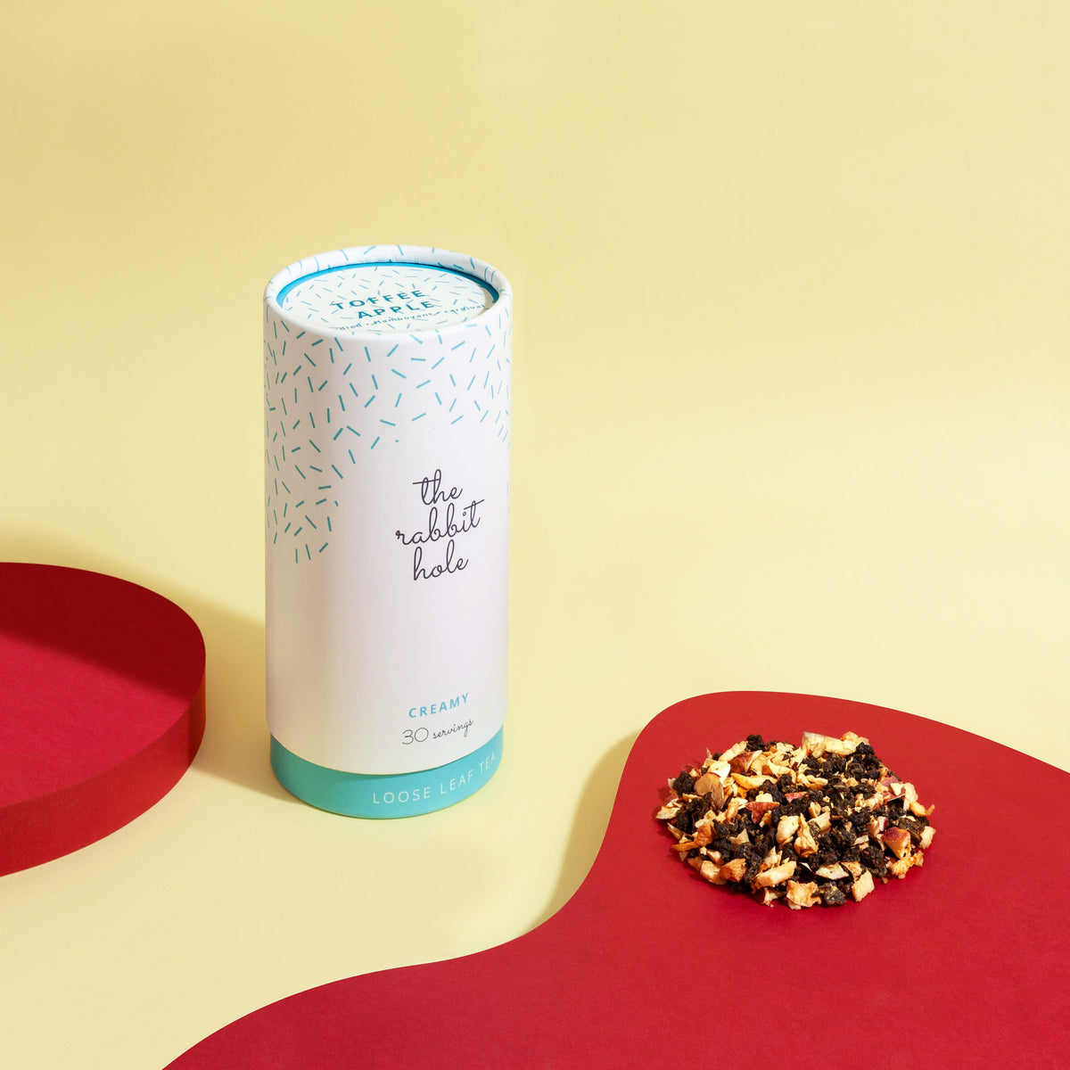 Toffee Apple loose leaf Creamy tea by The Rabbit Hole - Australian Made Tea - canister on a colourful yellow and red background