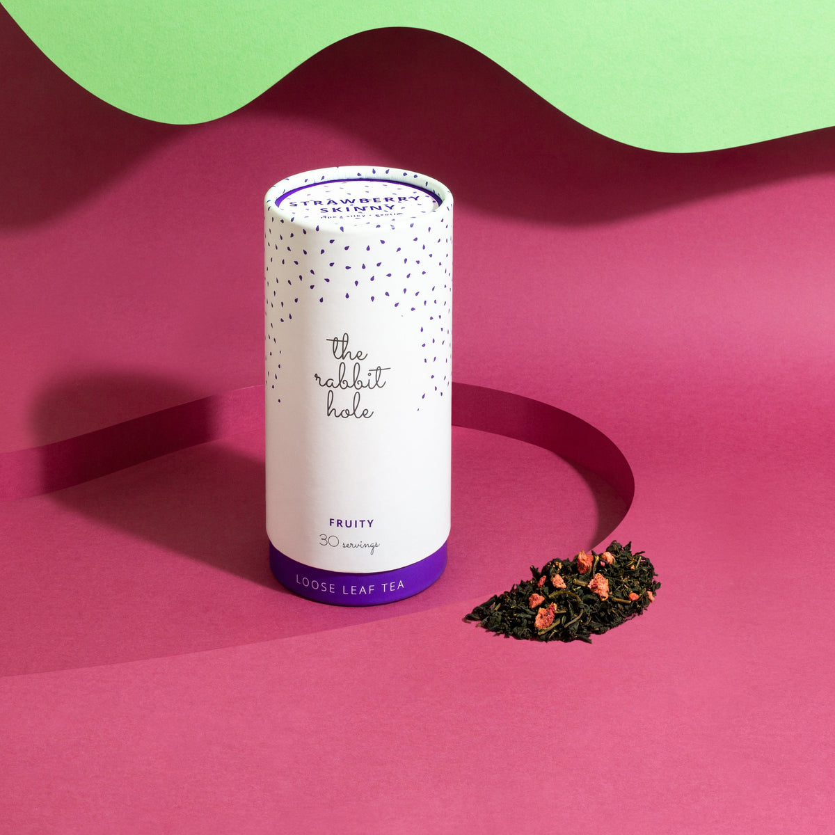 Strawberry Skinny Loose leaf Fruity tea by The Rabbit Hole - Australian Made Tea - canister on a bright pink and green background