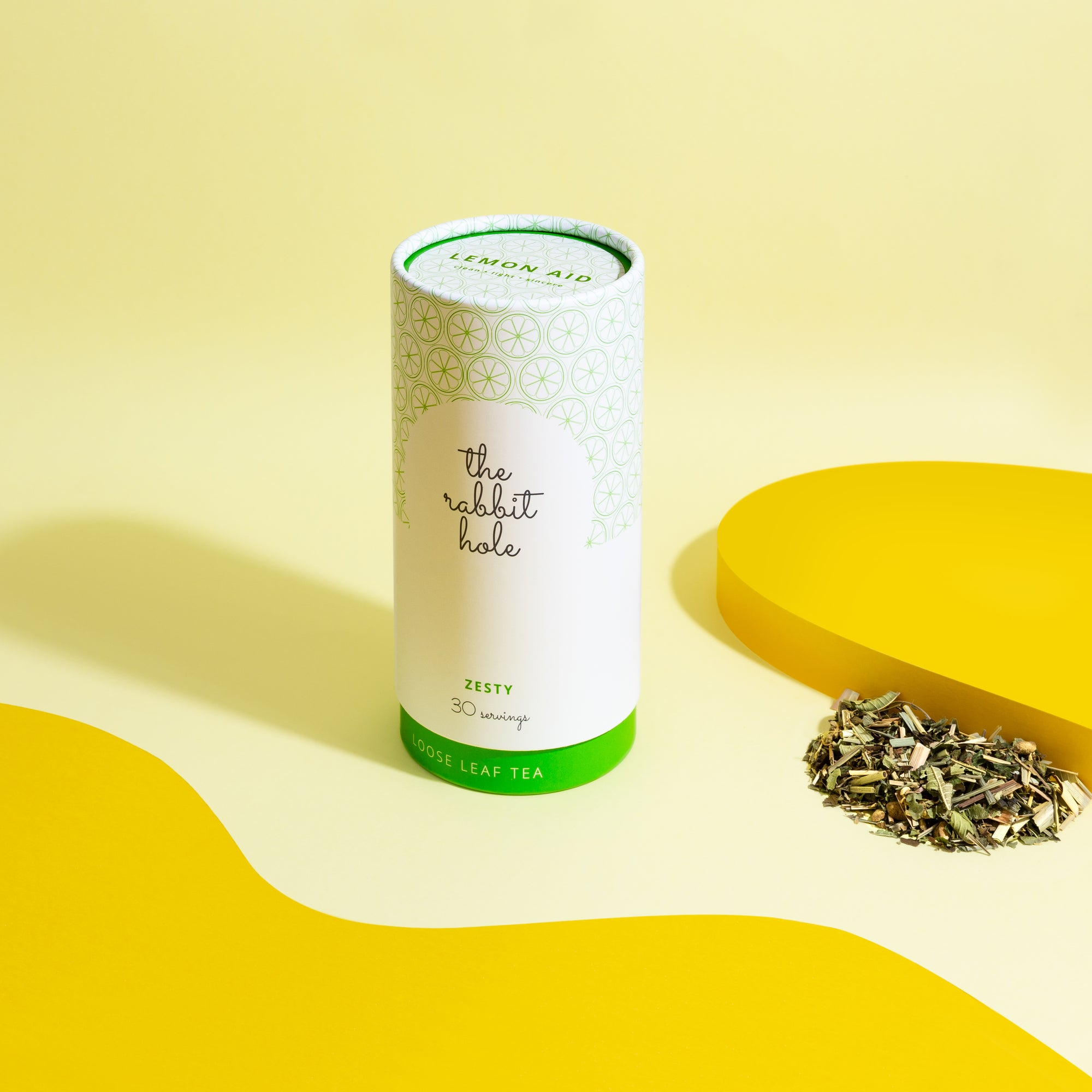 Lemon Aid loose leaf tea by The Rabbit Hole - Australian Made Tea. Tea canister on colourful yellow background