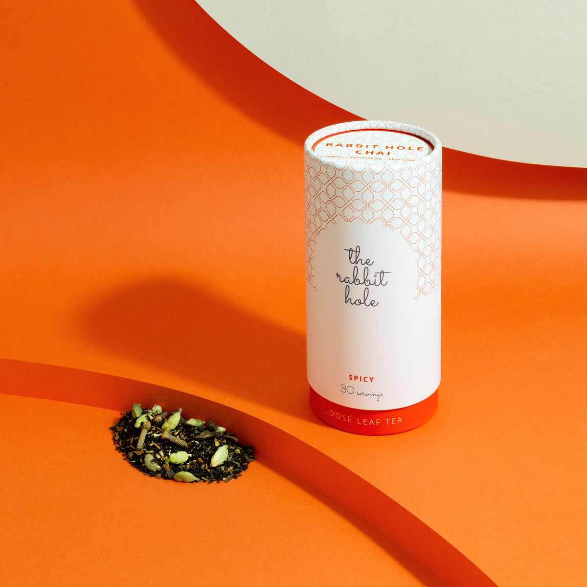 Rabbit Hole Chai loose leaf tea by The Rabbit Hole - Australian Made Tea. Tea canister on colourful orange background