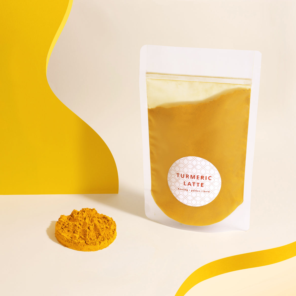 The Rabbit Hole Turmeric Latte powder in pouch on a white and yellow background