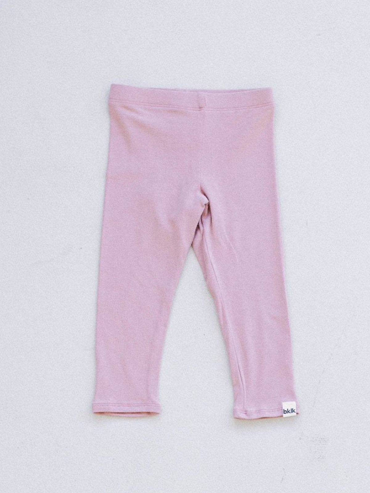 "pink, gender neutral colors, fitted body t-shirt and pants, soft jersey fabric. Sizes, baby, toddler, big kid, 6 mo 12 mo 1 yr 2 yr 3yr 4yr 5yr 6yr 7yr 8yr old. Ethically + sustainably made in  California, USA. long in back, Leggings w/ 1"" elastic"