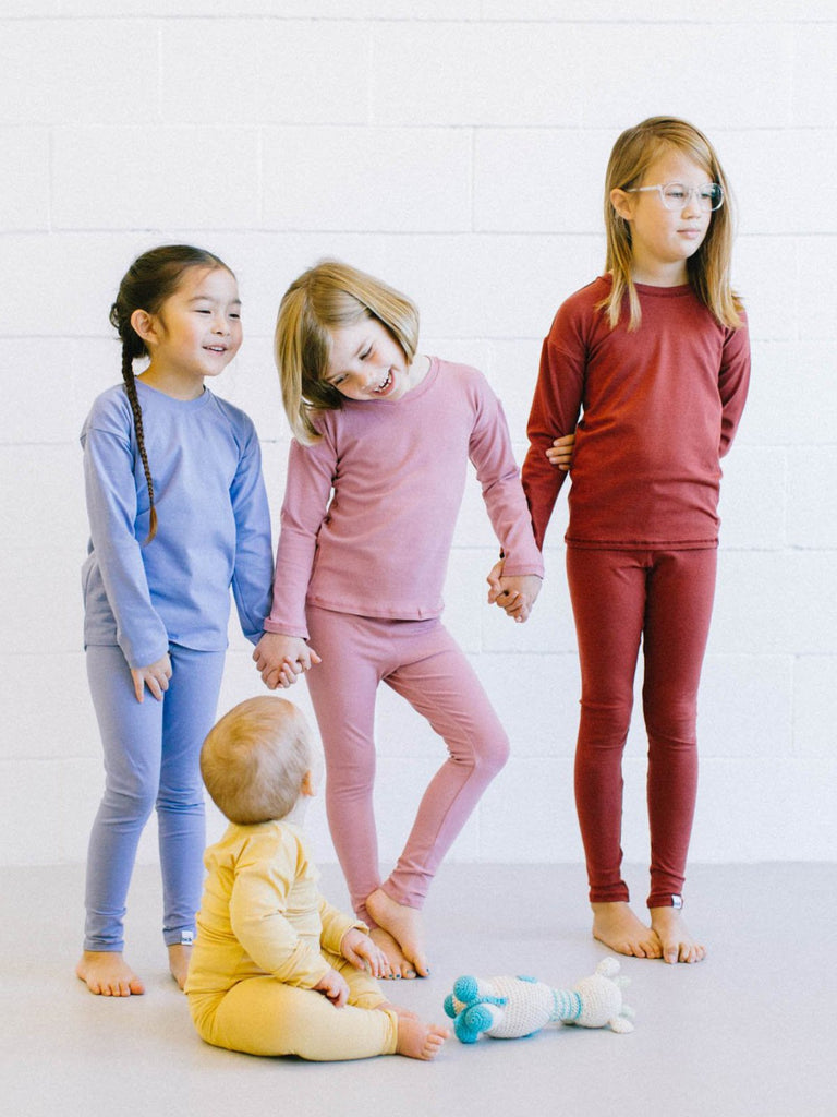 "gender neutral colors, fitted body t-shirt, soft jersey fabric. Sizes, baby, toddler, big kid, 6 mo 12 mo 1 yr 2 yr 3yr 4yr 5yr 6yr 7yr 8yr old. Ethically + sustainably made in  California, USA. long in back, Leggings w/ 1"" elastic"