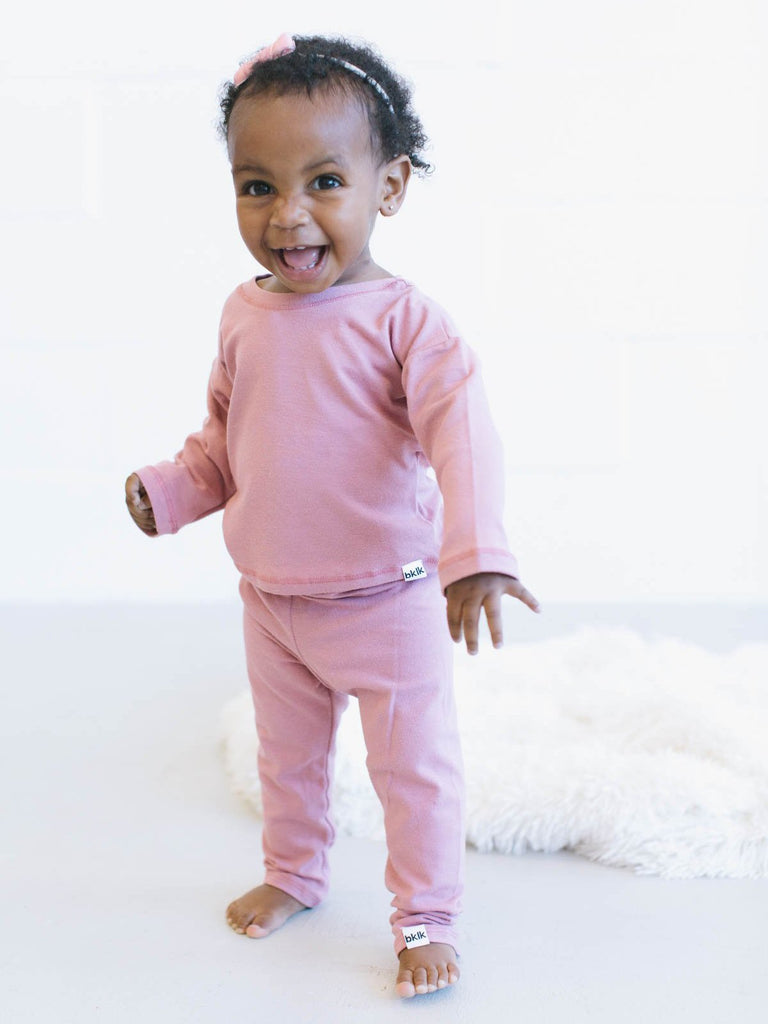 "pink, gender neutral colors, matching body t-shirt and pants, soft jersey fabric. Sizes, baby, toddler, big kid, 6 mo 12 mo 1 yr 2 yr 3yr 4yr 5yr 6yr 7yr 8yr old. Ethically + sustainably made in  California, USA. long in back, Leggings w/ 1"" elastic, African American baby girl"