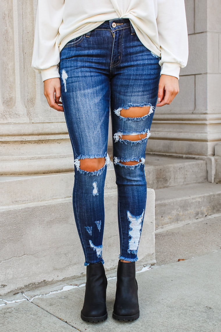 James Mid Rise Distressed Skinny