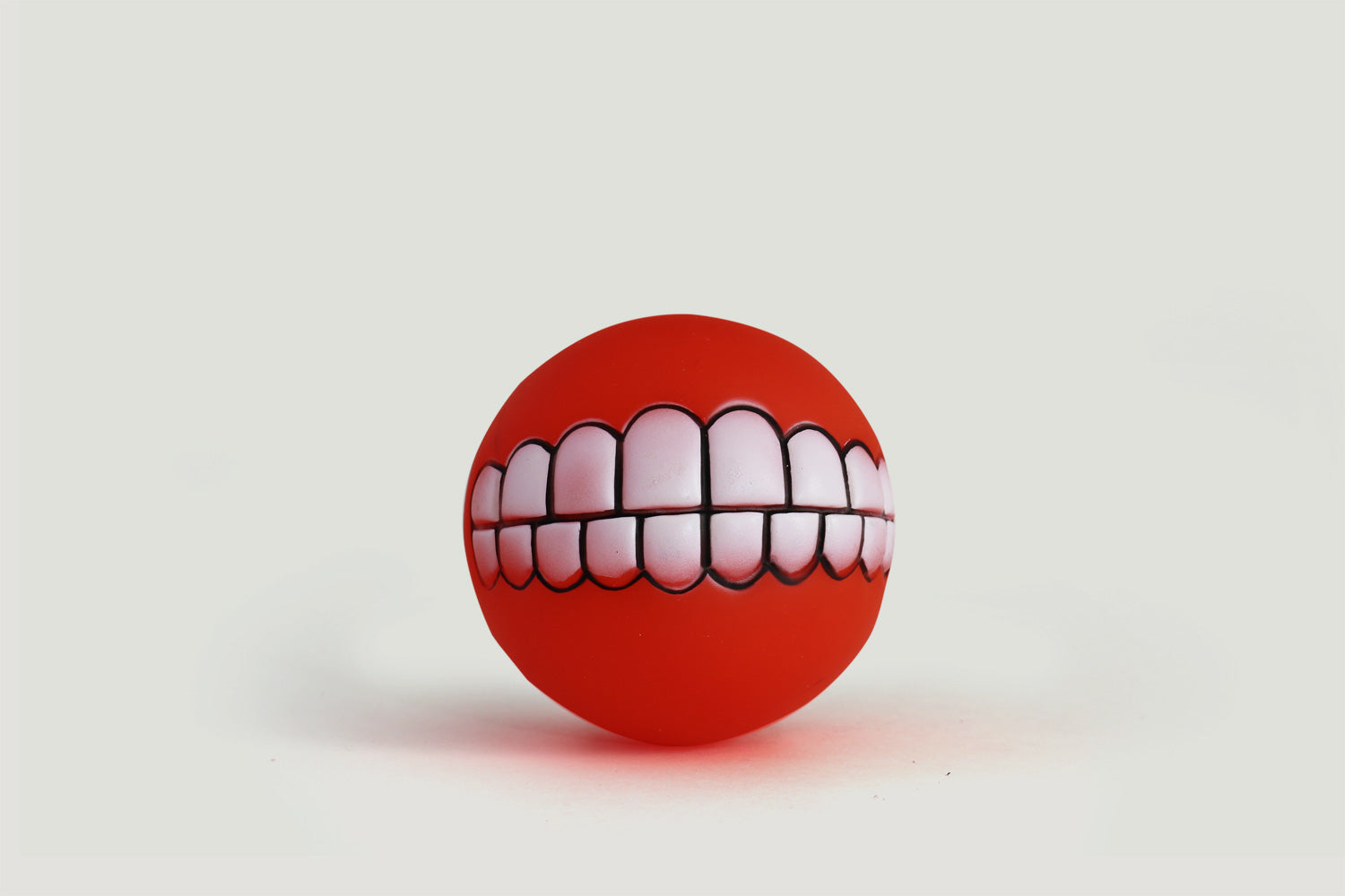 """Put a Smile On"" Dog Squeaker Ball"