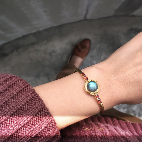 Vintage Imperial rainbow labradorite set with garnet cuff  in 18K gold