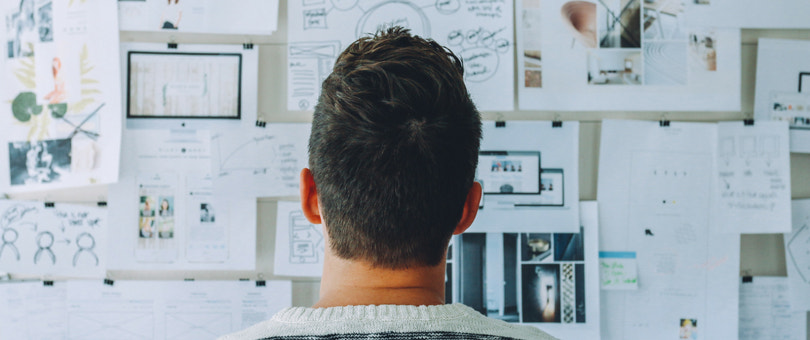 Man looking at market research | Shopify Retail blog